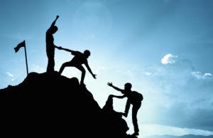 climbing helping team work success winner concept