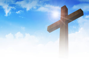 A cross on clouds background, christianity, religious theme